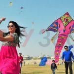 Couple enjoying kite flying - Kite Flying Show & Event